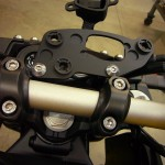 New low profile bracket mounted to stock location using factory hardware.