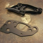 Stock plastic mount and new machined aluminum mount...